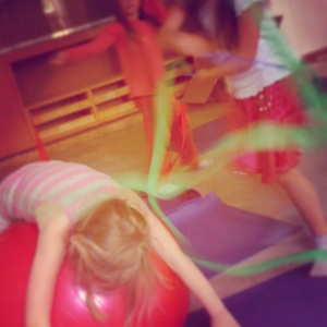 actlab participants use balls and ribbons to explore organic shapes through movement.